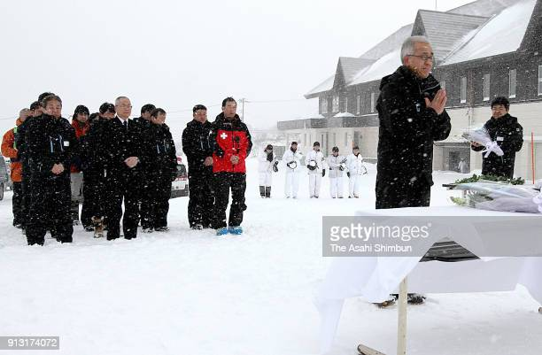 Kusatsu Kokusai Ski Resort staffs observe a munute of silence a week after its eruption of Mt MotoShiranesan on January 30 2018 in Kusatsu Gunma...