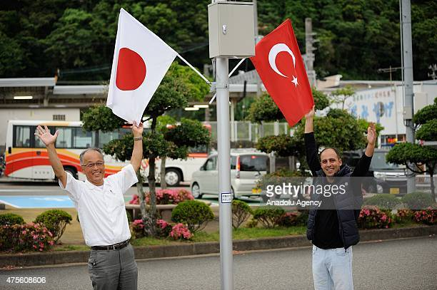 Kushimoto local resident and a Turkish man express TurkishJapan friendship and celebrate the arrival of the Turkish navy frigate TCG GEDIZ in...