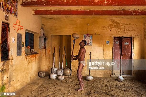Kushti wrestler training with a gada, a mace made of rock and iron, in a small akhara of Varanasi, Uttar Pradesh, India. Pehlwani or kushti is a form...