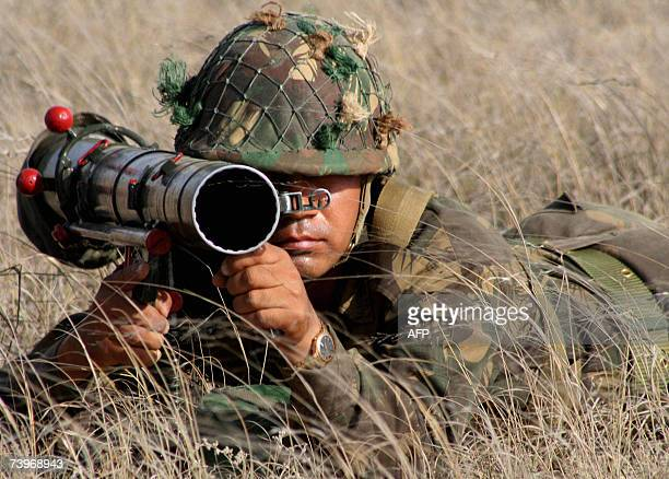 An Indian Army soldier from the 'Bald Eagles' of the Golden Katar Infantry Division looks through the sights of a rocket launcher during an army...