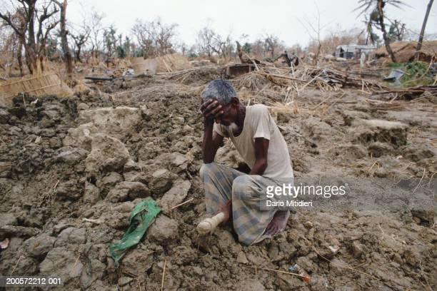 Kutubdia Island Bangladesh Distraught man after a cyclone hit Kutubdia Island 40000 of population of 110000 reported dead Bangladesh May 1991