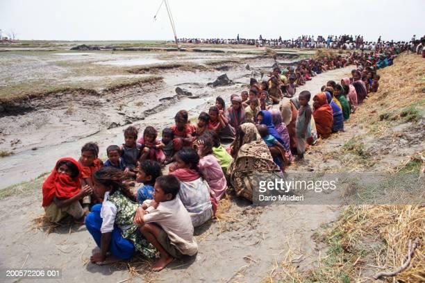Kutubdia Island Bangladesh Survivors gather after a cyclone hit Kutubdia Island 40000 of population of 110000 reported dead Bangladesh May 1991