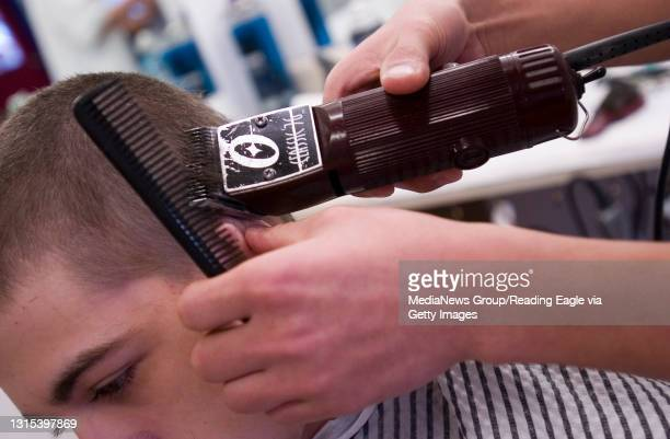 Kutztown, PA 200700182- Jon Escueta cuts the hair of Dylan Murphy of Whitehall.The City Cuts Barbershop on North Constitution Street in Kutztown, PA...
