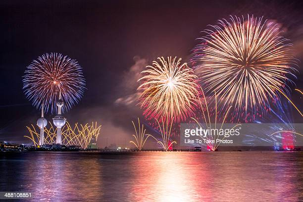 kuwait 50th constitution anniversary fireworks - kuwait city stock pictures, royalty-free photos & images