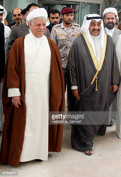 Former Iranian President and head of the Expediency Council Akbar Hashemi Rafsanjani walks with Kuwait's parliament speaker Jassem Al Kharafi at the...