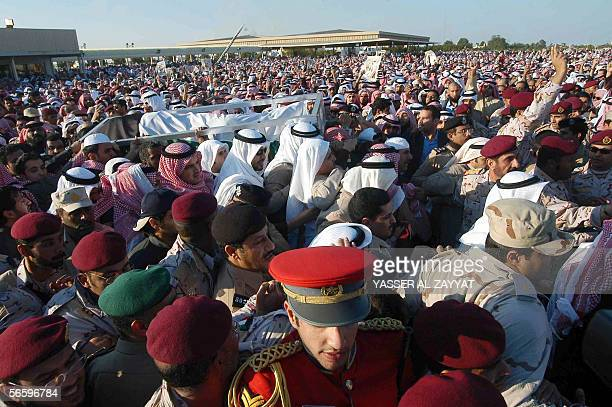 Kuwaitis carrying the coffin of their late Emir Sheikh Jaber alAhmad alSabah who died Sunday aged 79 after 28 years in power arrive at the...