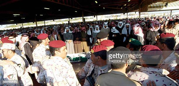 Kuwaitis pray over the coffin of their late Emir Sheikh Jaber alAhmad alSabah who died Sunday aged 79 after 28 years in power at the AlSulaybikhat...