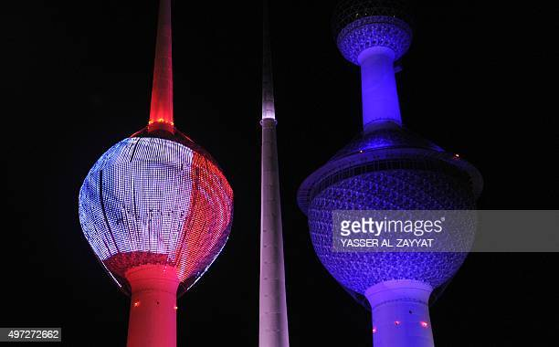 Kuwait City's landmark Kuwait Towers are seen illuminated in the colours of the French national flag on November 15 two days after deadly attacks in...
