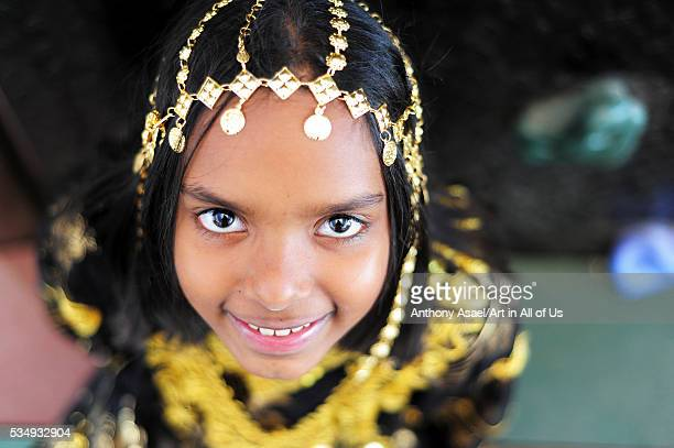 Kuwait Kuwait City Close up portrait of young girl in traditional dress with sharp eyes