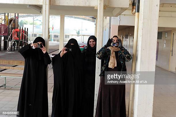 Kuwait Kuwait City teachers with burqas taking pictures