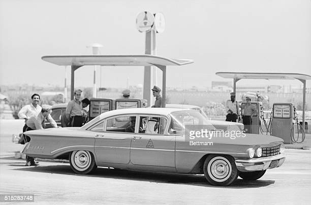 Oil Country A sleek modern American car is serviced at an equally modern gas station in Kuwait City where a gallon of gas costs about ten cents The...