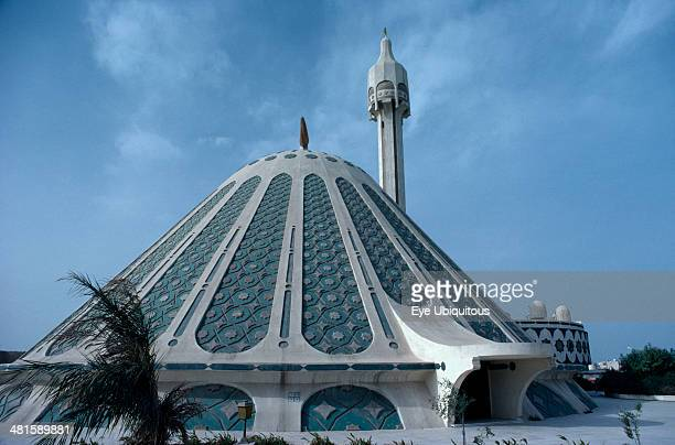 Kuwait Religion Exterior of modern conical shaped mosque and minaret