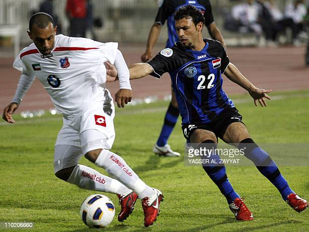 Kuwait SC club player Jarrah alAtiqi is challenged by Said Mohsen of Iraq's AlTalaba club during their 2011 AFC Cup football match in Kuwait City on...