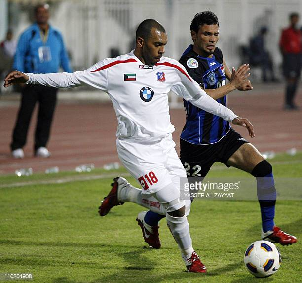 Kuwait SC club player Jarrah alAtiqi runs with the ball as he vies with Said Mohsen of Iraq's AlTalaba club during their 2011 AFC Cup football match...