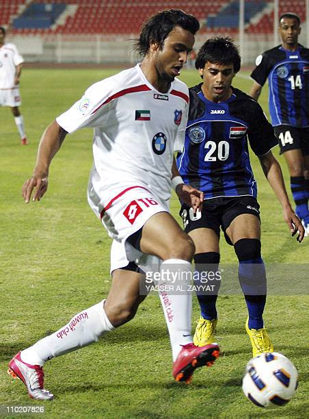 Kuwait SC club player Khaled alAzemi challenges Ihab Kadhim of Iraq's AlTalaba club during their 2011 AFC Cup football match in Kuwait City on March...