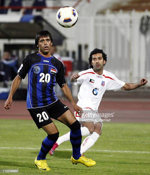 Kuwait SC club player Walid Ali eyes the ball with Ihab Kadhim of Iraq's AlTalaba club during their 2011 AFC Cup football match in Kuwait City on...