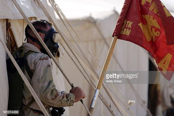 KuwaitA Marine dons a gas mask in what turned out to be one of three false alarms for the day at camp LSA5 Living support area five in northern...