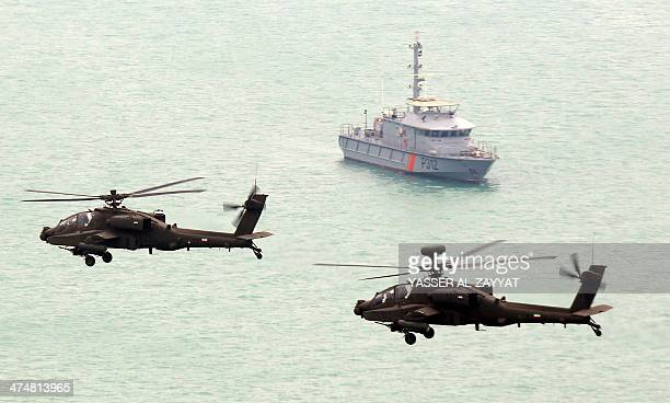 Kuwaiti air force Apache helicopters fly over on February 25 2014 during celebrations to mark the oilrich Gulf emirate's 53rd National Day and the...