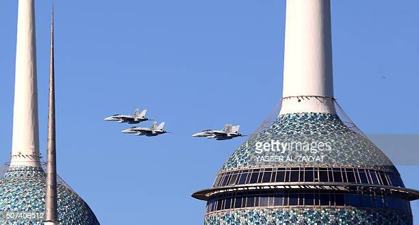 Kuwaiti Air Force pilots show their skills near Kuwait's towers during the launching ceremony of the Hala shopping festival in Kuwait City on January...