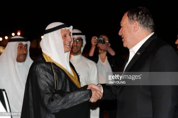 Kuwaiti ambassador in Washington Salem Abdullah alJaber alSabah greets US Secretary of State Mike Pompeo during his arrival at Kuwait International...