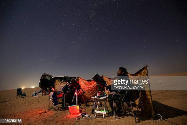 Kuwaiti astrophotographers follow the great conjunction between Jupiter and Saturn in al-Salmi district, a desert area 120 kms west of Kuwait City,...