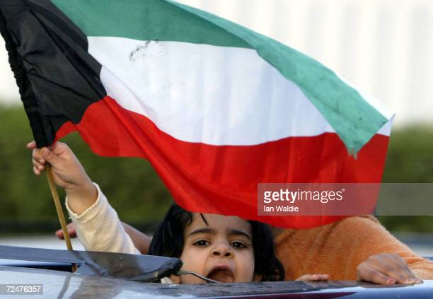 Kuwaiti child waves a national flag during celebrations for Kuwait Liberation Day February 26 2003 in Kuwait City Kuwait The celebrations mark the...