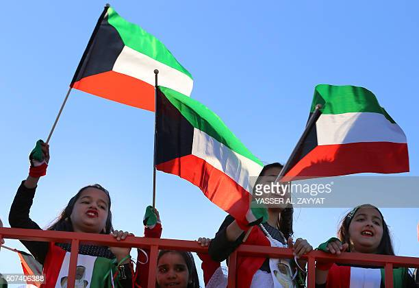 Kuwaiti children wave their national flag during the launching ceremony of the Hala shopping festival in Kuwait City on January 29 2016 The festival...