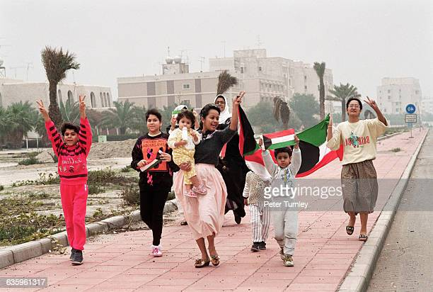 Kuwaiti citizens celebrate after liberation by American troops in the Gulf War