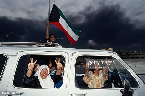 Kuwaiti civilians celebrate the liberation in the streets