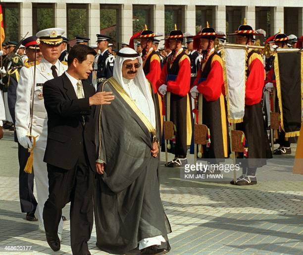 Kuwaiti defense minister Sherikh Salem Sabah AlSalemSabah is escorted by his South Korean counterpart Cho SungTae as they pass the traditional honor...