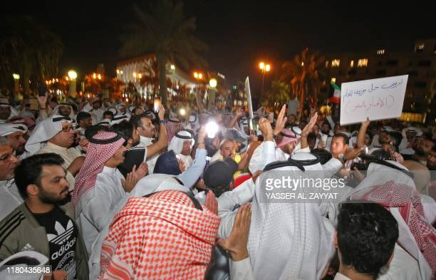 Kuwaiti demonstrators take part in a demonstration against corruption in Kuwait City on November 6, 2019. - Hundreds protested in front of Kuwait's...