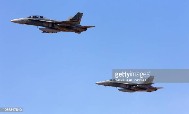 """Kuwaiti F/A-18 fighter jets fly during the Kuwaiti and French army forces closing ceremony of a joint drill code-named """"Pearl of the West"""", held at..."""
