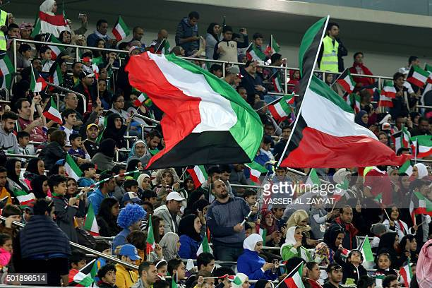 Kuwaiti fans wave the national flag ahead of a friendly ceremonial match between Kuwait allstars team and Football Champions Tour Legends on December...