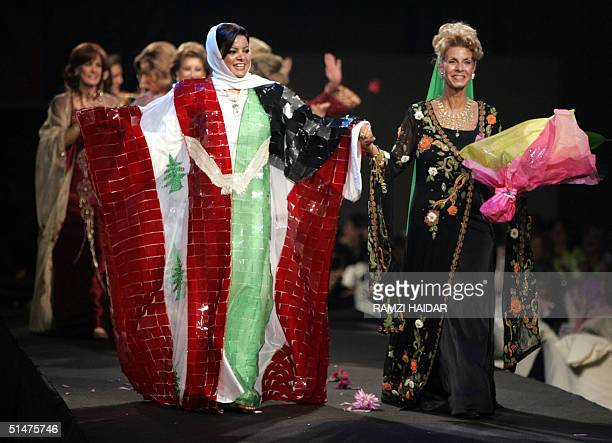 Kuwaiti fashion designer Adiba alMahbub wearing a gown with the colors and emblem of the Lebanese flag salutes the audience with her models all...