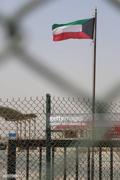 A Kuwaiti flag flutters on the Gulf emirate's side of the Safwan border crossing with Iraq south of the Iraqi port city of Basra on July 17 2014 AFP...