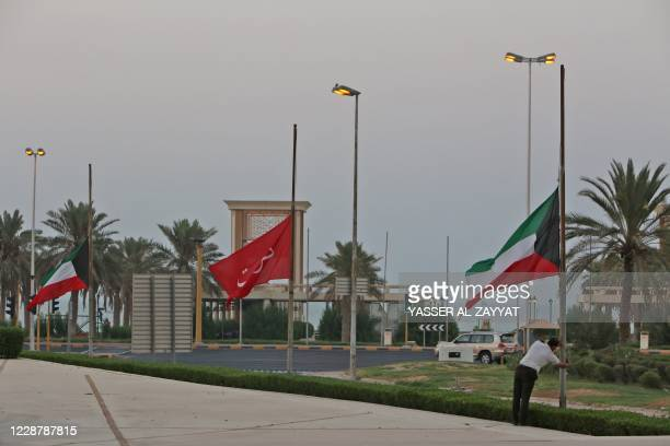Kuwaiti flags are lowered to half-mast outside the Dasman Diabetes Institute in Kuwait City on September 29 as the country mourns the death of emir...