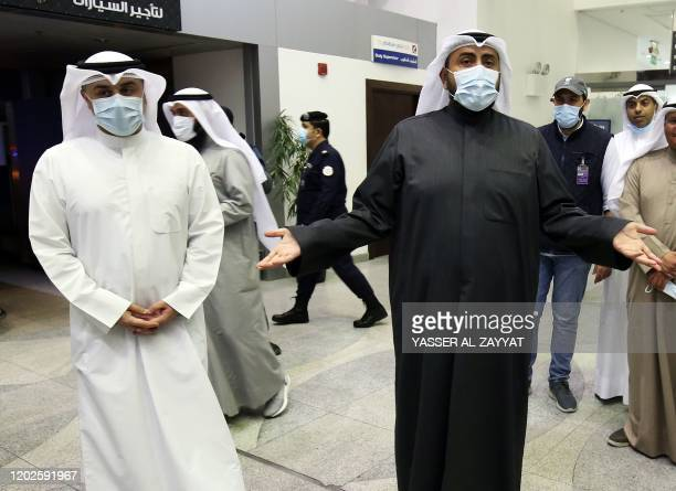 Kuwaiti health minister Sheikh Basel alSabah speaks to the press at Sheikh Saad Airport in Kuwait City on February 22 as Kuwaitis returning from Iran...