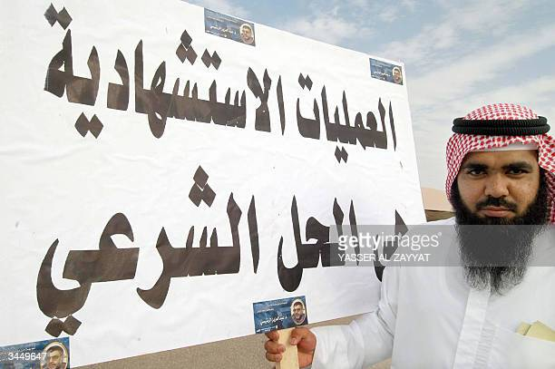 Kuwaiti Islamist holds a proHamas placard during a demonstration in Kuwait City 20 April 2004 to denounce Israel's assassination of the Islamic...