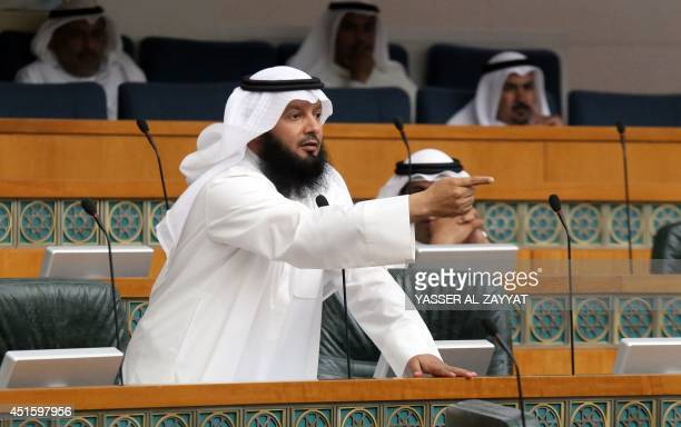 Kuwaiti Islamist parliament member Ahmad alAzmi gestures as he attends a parliament session at the national assembly on July 2 in Kuwait City...