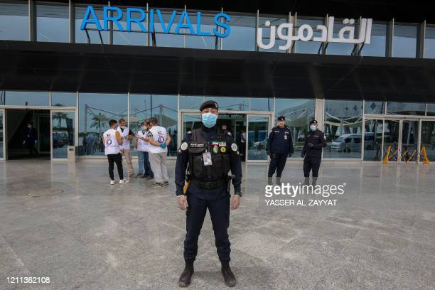 Kuwaiti Ismael al-Sarraf police officer, poses for a picture outside Kuwait international airport in Kuwait City on April 19, 2020 during the...