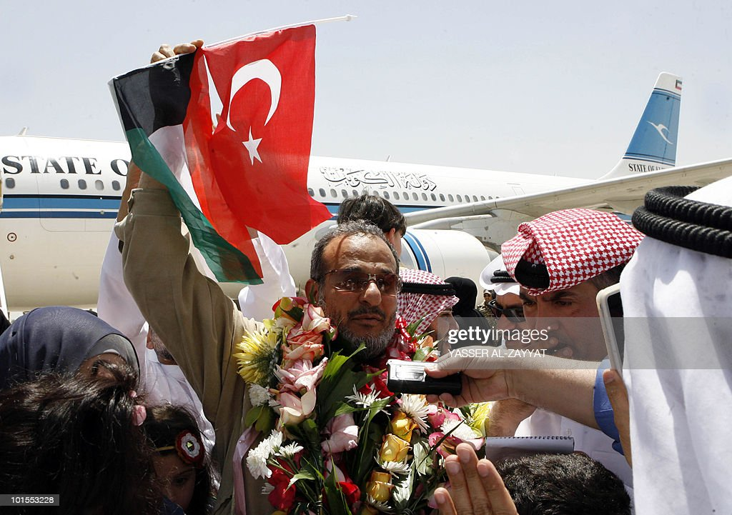 Kuwaiti lawyer, Mubarak al-Mutawaa, who was detained aboard the Gaza-bound flotilla raided by Israel on May 31, 2010, holds up Kuwaiti and Turkish flags upon his arrival at Kuwait City airport on June 2, 2010 after he was deported from Israel.
