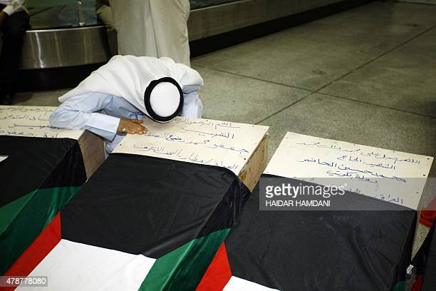 A Kuwaiti man mourns over the coffin of a relative who lost his life during the suicide bombing on the AlImam AlSadeq mosque bombing in Kuwait upon...