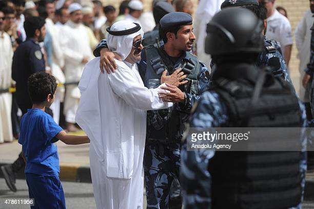 Kuwaiti man reacts following a suicide bomb attack targeting the Imam Sadiq Mosque in the Sawaber area of Kuwait City on June 26 2015 Ten people were...