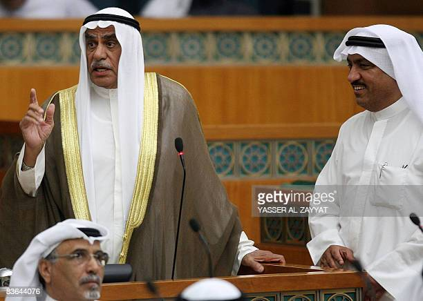 Kuwaiti member of parliament Musallam alBarrak smiles as MP Ahmad alSadun speaks during a parliament session in Kuwait City on November 11 2008...