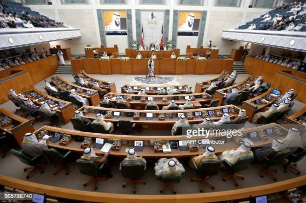 Kuwaiti members of National Assembly attend the opening ceremony of the new legislative year at the National Assembly in Kuwait City on October 24...