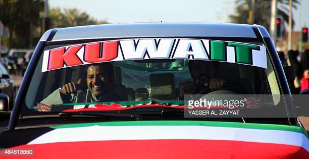 Kuwaiti men gesture during celebrations marking the Gulf state's 54th Independence Day and the 24th anniversary of the end of the Gulf war with the...