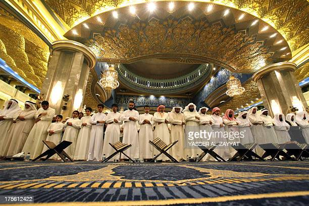 Kuwaiti men pray at the Grand Mosque in Kuwait City early on August 2013 on the night of Lailat alQadr which marks the revelation of the Koran...