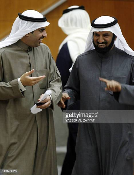 Kuwaiti MPs Khaled alAdwa and Khaled alTahous attend a parliament session at the national assembly hall in Kuwait City on February 3 2010 Kuwait's...