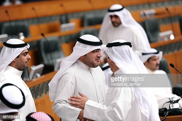 Kuwaiti MPs Riyadh alAdasani and Abdulkarim alKundari exit the room after announcing their resgination from the National Assembly during a parliament...