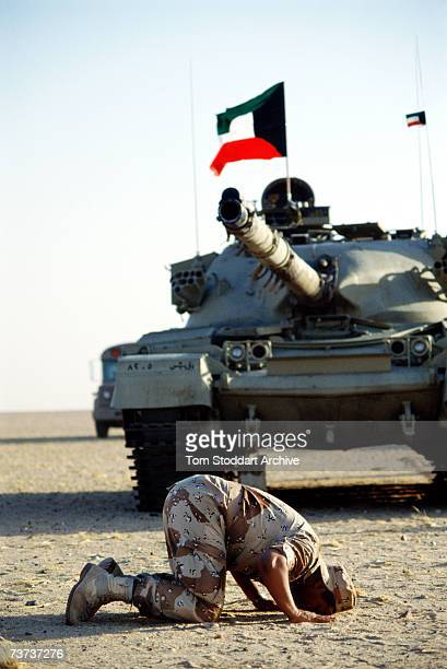 A Kuwaiti Muslim tank crew gunner praying to Allah during desert training in Dhahran Saudi Arabia before the allied intervention in Kuwait during the...